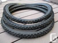 "Three 26"" x 2.1 Schwalbe ""Ice Spiker"" tires for sale."