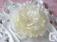 1) An ivory 5'' peony fabric and lace flower with