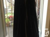 I purchased this charming black cloak at the now-closed