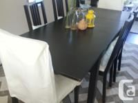 Extendable dining table with 2 extra leaves seats.