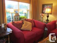 Beautiful red sofa and loveseat will add a spring feel