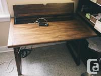 This sturdy wooden desk is stylish and functional and