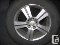 Aluminum Rims with Good Year Assurance tires mounted on