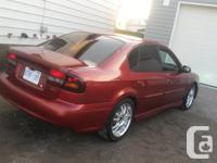 Make Subaru Year 2002 Colour red pearl kms 208600 2002