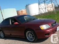 Make Subaru Model Legacy Year 2002 Colour red pearl