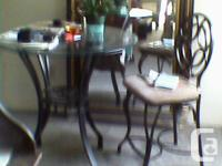 glass table finished wrought iron frame two chairs same