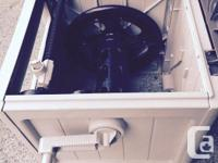 Sun cast hose reel with hidden hose and track guide to