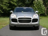 Make Porsche Model Cayenne Year 2004 Colour Grey kms