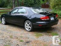 Make Mazda Model Millenia Year 2001 Colour black kms