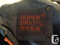 A great Superdry black, orange and grey coat in a