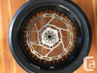 Brand new never used warp 9 supermoto wheel set with