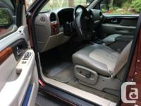 Make GMC Model Envoy 4X4 SLE Year 2003 Colour Red kms