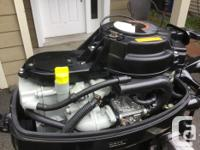 Suzuki 9.9 hp long shaft. Electric start . Battery