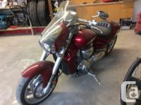 Candy red. Very low miles. Second owner. Mature rider.