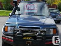 Suzuki Sidekick JLX Sport -Vehicule modifie pour faire