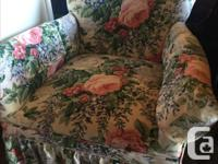 Small armchair upholstered in a nice floral pattern.