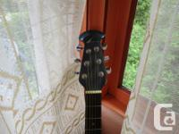 Here is a sweet old Ovation guitar for sale. Nice