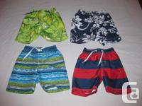 I am selling 4 pairs of swim trunks / bathing suits for