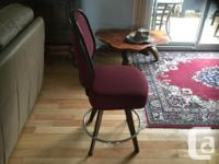 2 burgundy swivel stools in great condition. No rips,