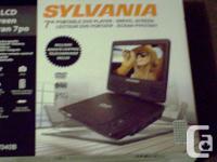 "NEW SYLVANIA 7"" PORTABLE DVD PLAYER, TERRIFIC FOR"