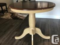 Pier One Imports Mango wood table with two Parson's