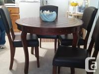 "Excellent condition. Just like new. 42"" Table and 4"