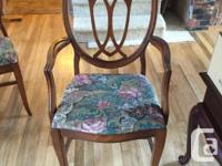 Table and chairs, needs refinishing but is sturdy, has