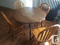 4 wooden chairs and small table. Drop by with a truck