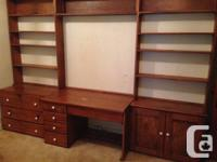 Large, wooden, wall-unit with a lot of drawer area as