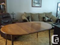 Solid in Good condition table with 5 chairs & 2 leafs.