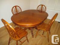 "Oak, Oval pedestal table (58"" (L) x 42"" (W) with leaf"