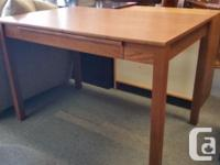 This table style desk has a great pullout keyboard
