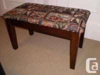 Appealing little bench for sale. New upolstery. Tough