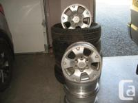 """Four 16"""" inch Toyota Tacoma rims with tires. Rims have"""
