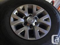Never been used set of five tires and 4 rims. Off of a
