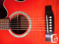 A beautiful Takamine with cut-away and electronics. My