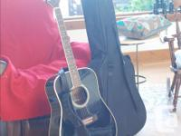 This guitar is for sale on SALTSPRING ISLAND. Just so