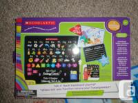 Introduces letters, numbers and phonics. Includes mat,