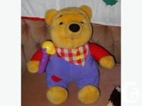 talking winnie the pooh...put the honey cone to his