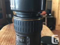 Very light,compact, sharp macro lens. Has a push-pull