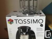 This Tassimo T20 Brewer is practically brand new. Been