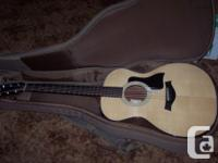 Up for grabs is my TAYLOR 114e acoustic guitar in