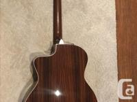 This is a taylor 214ce-dlx model in very good