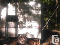 Taylor Coach travel trailer. 10 Foot long. One side