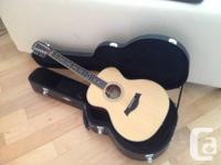 Taylor guitar in excellent state. Simply accustomeded