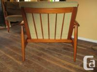 This teak armchair has been totally restored to its