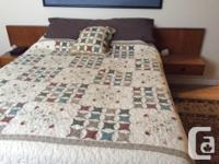 Queen size bed includes headboard with built in side