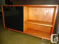 Selling a very solid teak cabinet with opaque sliding