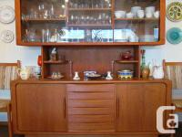 Solid teak china cabinet with upper sliding glass