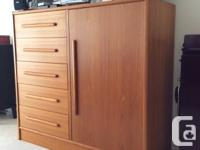 Teak dresser with shelves and drawers. Excellent